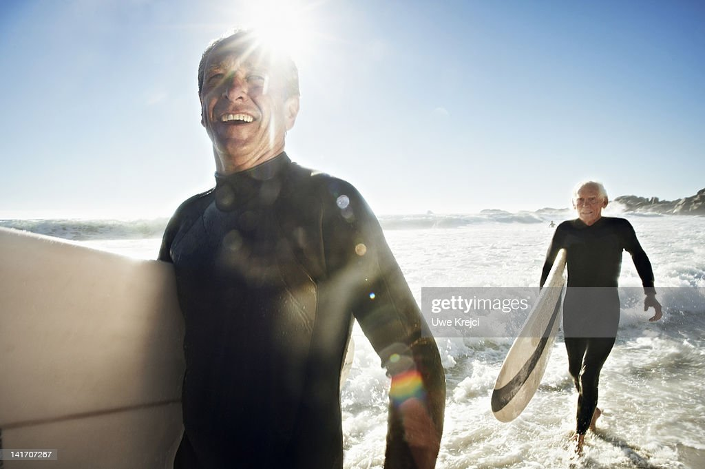 Senior Surfers on beach, close up : Stock Photo