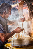 Senior Swiss Farmer making cheese