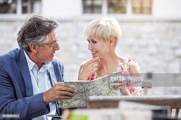 Senior Tourists Looking at the City Map
