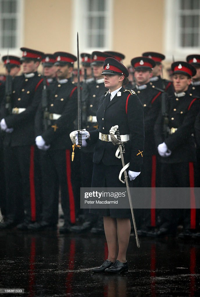 Senior Under Officer Sarah Hunter-Choat stands with the Sword of Honour, awarded to the best overall officer cadet, during the Sovereign's Parade at the Royal Military Academy at Sandhurst on December 14, 2012 in England. The parade marks the completion of 44 weeks of training for 200 young people who will be commissioned into the British Army and the armies of 13 overseas countries.