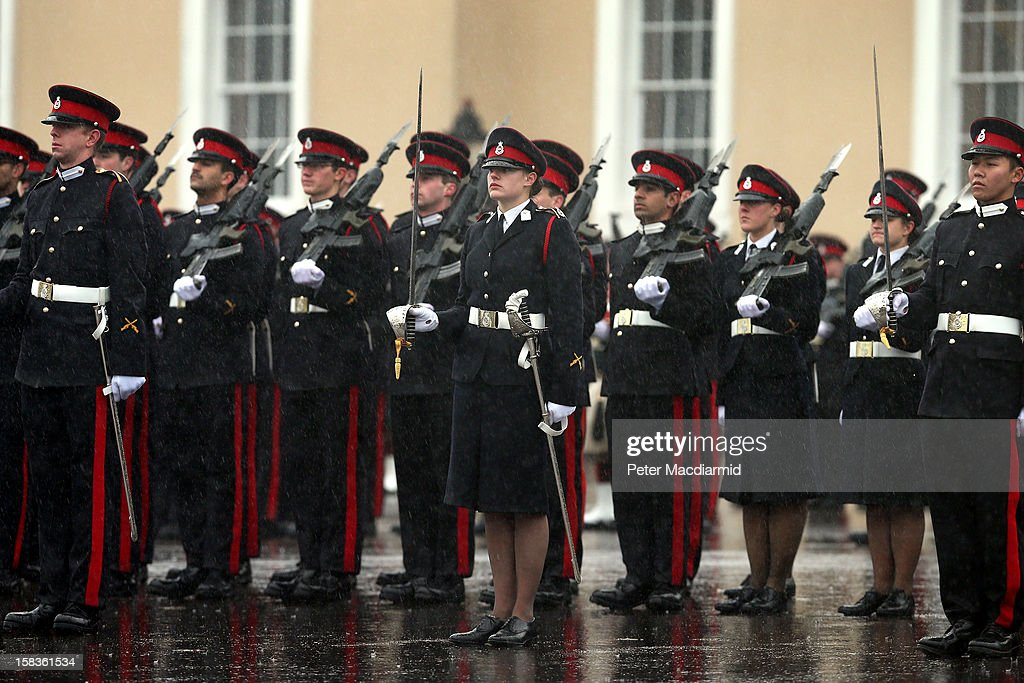 Senior Under Officer Sarah Hunter-Choat (C) stands with the Sword of Honour, awarded to the best overall officer cadet, during the Sovereign's Parade at the Royal Military Academy at Sandhurst on December 14, 2012 in England. The parade marks the completion of 44 weeks of training for 200 young people who will be commissioned into the British Army and the armies of 13 overseas countries.