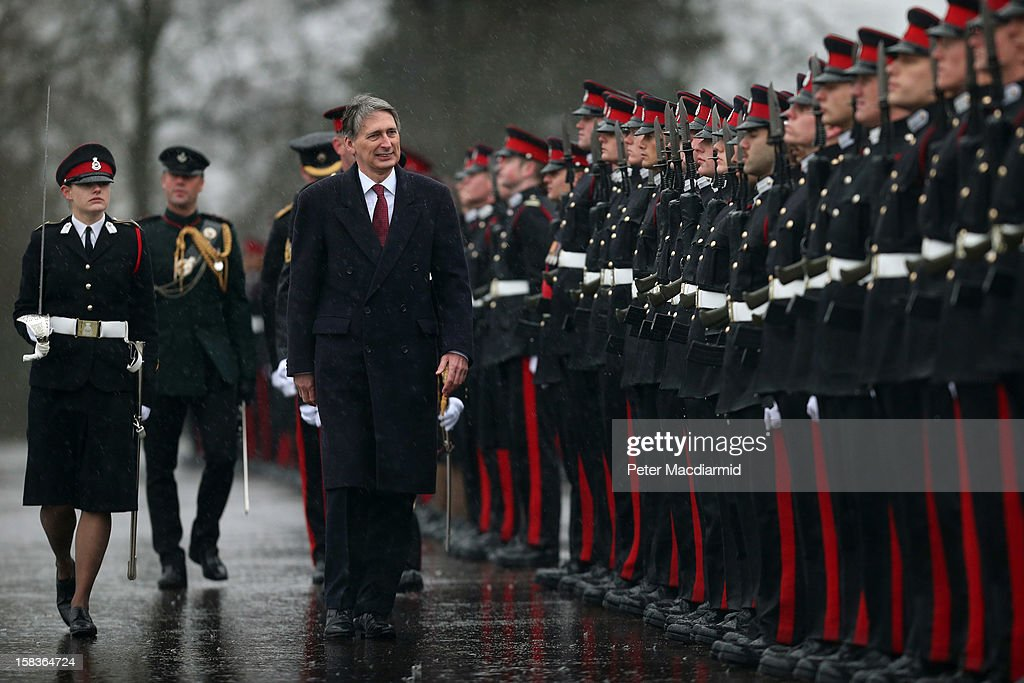 Senior Under Officer Sarah Hunter-Choat (L), winner of the Sword of Honour, accompanies Defence Secretary Philip Hammond (3rd L) during the Sovereign's Parade at the Royal Military Academy at Sandhurst on December 14, 2012 in England. The parade marks the completion of 44 weeks of training for 200 young people who will be commissioned into the British Army and the armies of 13 overseas countries. Senior Under Officer Sarah Hunter-Choat became the fourth woman in the Royal Military Academy's history to receive the prestigious Sword of Honour which is awarded to the best Officer Cadet on the course.