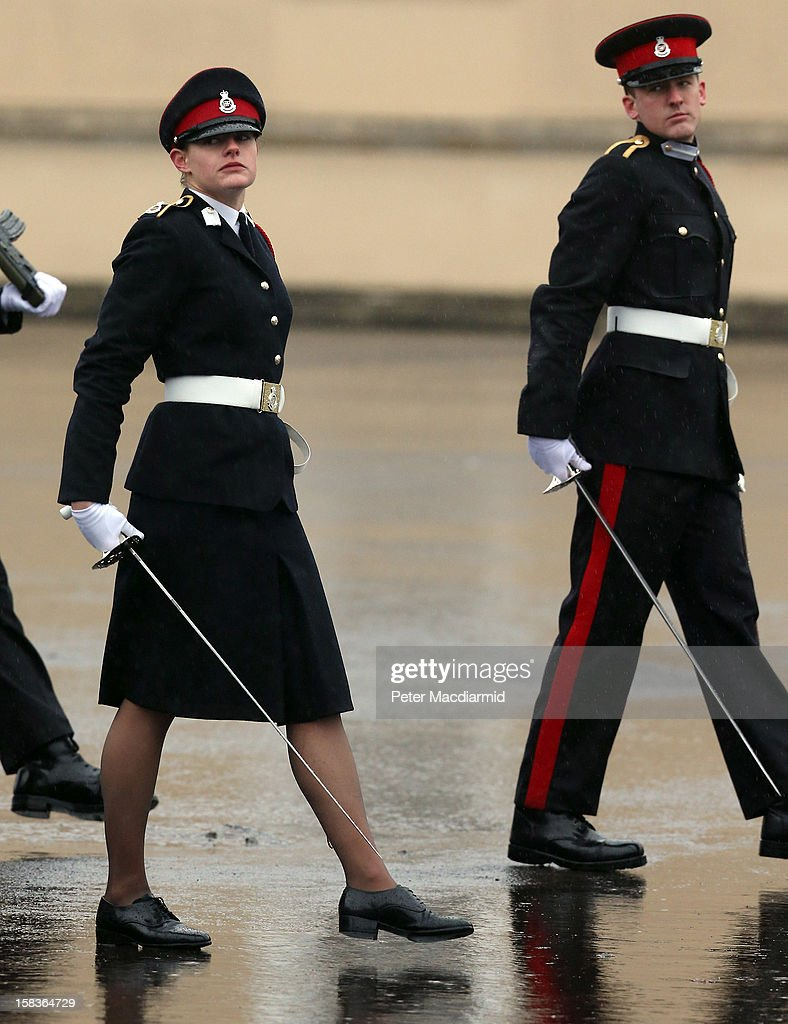 Senior Under Officer Sarah Hunter-Choat, winner of the Sword of Honour, takes part in the Sovereign's Parade at the Royal Military Academy at Sandhurst on December 14, 2012 in England. The parade marks the completion of 44 weeks of training for 200 young people who will be commissioned into the British Army and the armies of 13 overseas countries. Senior Under Officer Sarah Hunter-Choat became the fourth woman in the Royal Military Academy's history to receive the prestigious Sword of Honour which is awarded to the best Officer Cadet on the course.