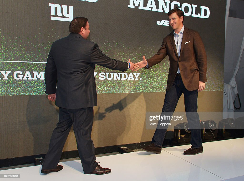 Senior Vice President, Ad Sales Keith Kazerman (L) and NFL player Eli Manning speak onstage at DIRECTV's 2013 National Ad Sales Upfront on May 7, 2013 in New York City.