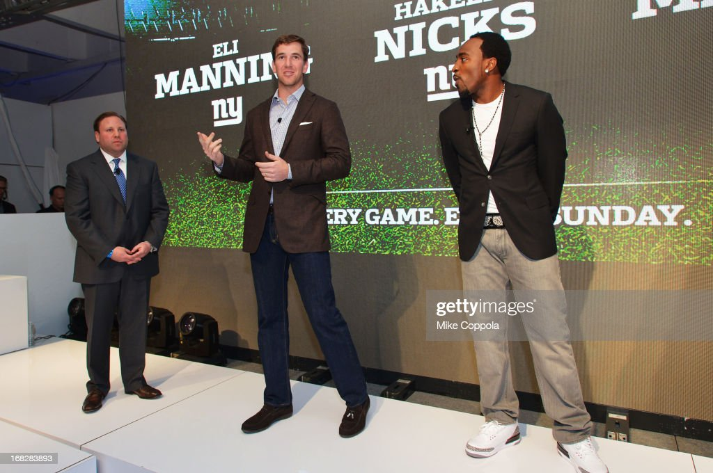 Senior Vice President, Ad Sales, Keith Kazerman, NFL Players Eli Manning and Hakeem Nicks speak onstage at DIRECTV's 2013 National Ad Sales Upfront on May 7, 2013 in New York City.