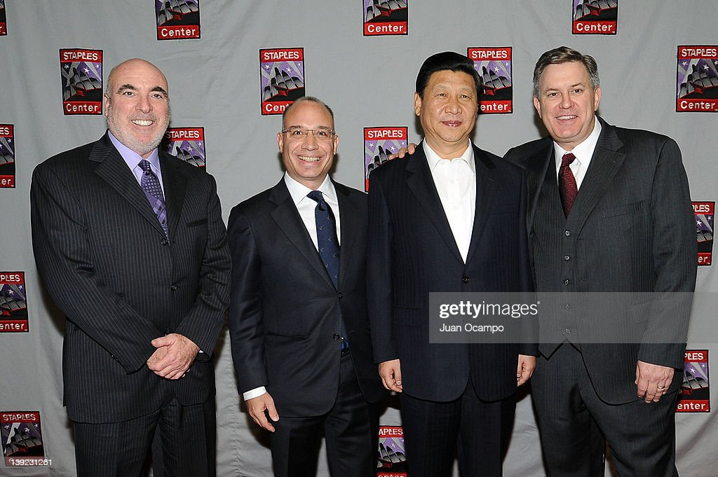 Senior Vice President and General Manager of Staples Center Lee Zeidman, President and CEO of AEG China John Cappo, Chinese Vice President <a gi-track='captionPersonalityLinkClicked' href=/galleries/search?phrase=Xi+Jinping&family=editorial&specificpeople=2598986 ng-click='$event.stopPropagation()'>Xi Jinping</a>, and AEG President & CEO <a gi-track='captionPersonalityLinkClicked' href=/galleries/search?phrase=Tim+Leiweke&family=editorial&specificpeople=676996 ng-click='$event.stopPropagation()'>Tim Leiweke</a> pose for a photograph during a game between the Phoenix Suns and the Los Angeles Lakers on February 17, 2012 at Staples Center in Los Angeles, California.