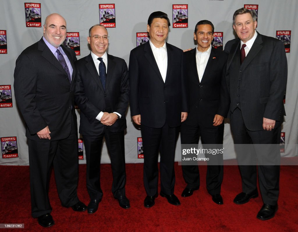 Senior Vice President and General Manager of Staples Center Lee Zeidman, President and CEO of AEG China John Cappo, Chinese Vice President <a gi-track='captionPersonalityLinkClicked' href=/galleries/search?phrase=Xi+Jinping&family=editorial&specificpeople=2598986 ng-click='$event.stopPropagation()'>Xi Jinping</a>, Los Angeles Mayor <a gi-track='captionPersonalityLinkClicked' href=/galleries/search?phrase=Antonio+Villaraigosa&family=editorial&specificpeople=178925 ng-click='$event.stopPropagation()'>Antonio Villaraigosa</a>, and AEG President & CEO <a gi-track='captionPersonalityLinkClicked' href=/galleries/search?phrase=Tim+Leiweke&family=editorial&specificpeople=676996 ng-click='$event.stopPropagation()'>Tim Leiweke</a> pose for a photograph during a game between the Phoenix Suns and the Los Angeles Lakers on February 17, 2012 at Staples Center in Los Angeles, California.