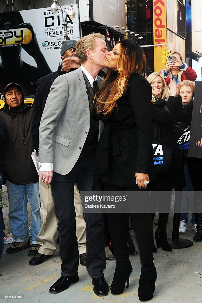 Senior Vice President Dan Matthews and TV personality Wendy Williams attend Wendy Williams 'I'd Rather Go Naked Than Wear Fur' Winter PETA Campaign Launch at Times Square on November 28, 2012 in New York City.