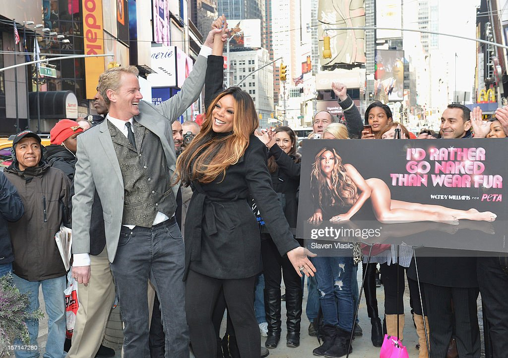 Senior Vice President Dan Matthews and Wendy Williams attend Wendy Williams 'I'd Rather Go Naked Than Wear Fur' Winter PETA Campaign Launch at Times Square on November 28, 2012 in New York City.