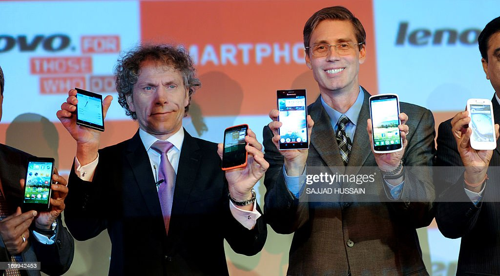Senior vice president Lenovo group, Milko Van Duijl (L) and vice president of Mobile Internet Digital Home, JD Howard display newly launched Lenovo smart phones at a function in New Delhi on June 5, 2013. Lenovo launched a wide range of smartphones in the city.