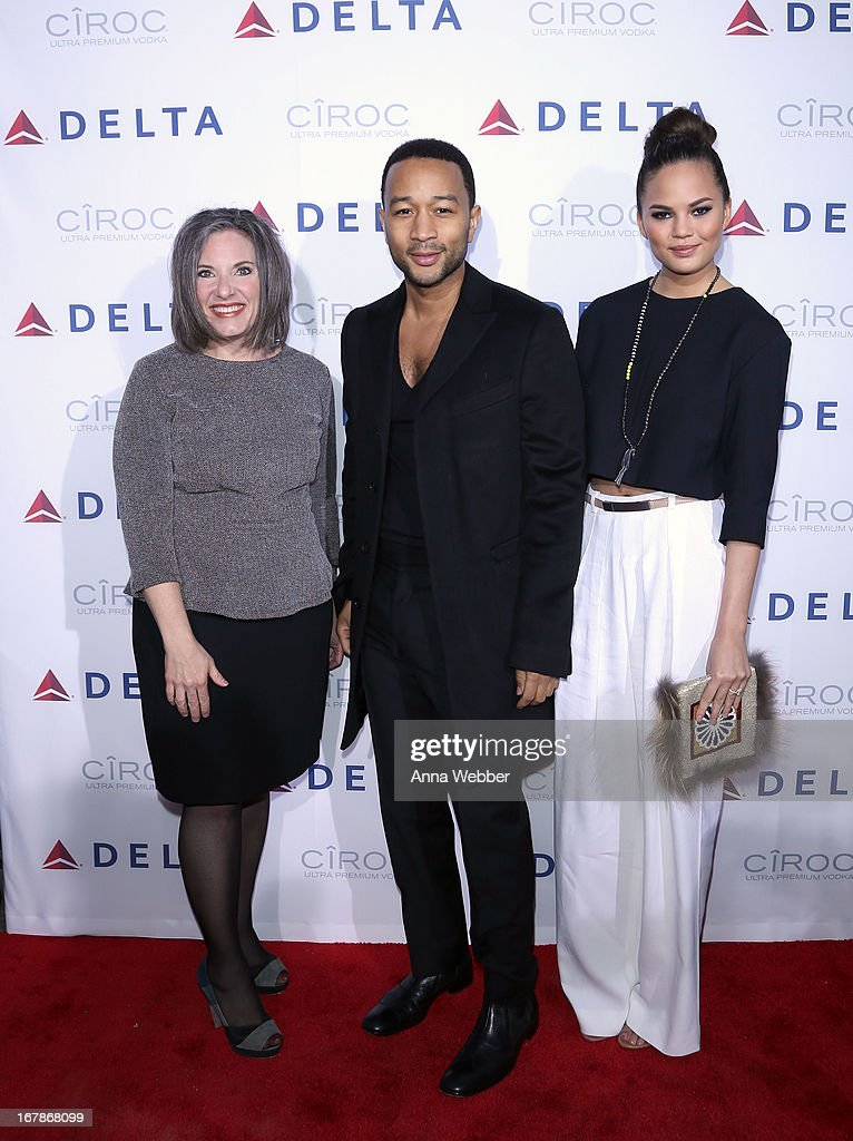 Senior Vice President of Delta Airlines Gail Grimmett, <a gi-track='captionPersonalityLinkClicked' href=/galleries/search?phrase=John+Legend&family=editorial&specificpeople=201468 ng-click='$event.stopPropagation()'>John Legend</a> and Chrissy Teigen attend as Delta Air Lines celebrate the opening night of T4X, a pop up experience showcasing distinctive features of the airline's newly transformed international hub at JFK's Terminal 4 on May 1, 2013 in New York City.