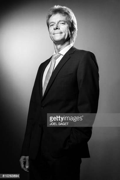 Senior Vice President of German news agency DPA Matthias Mahn poses during a photo session in Paris on July 6 2017 / AFP PHOTO / JOEL SAGET / BLACK...