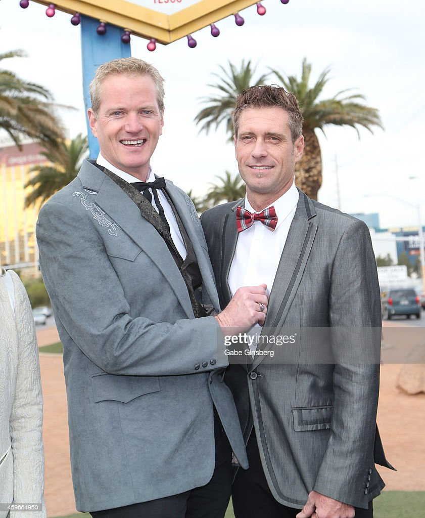Senior Vice President of media campaigns for PETA Dan Mathews (L) and his husband, production designer Jack Ryan, pose during their the wedding at the Welcome to Fabulous Las Vegas sign on November 27, 2014 in Las Vegas, Nevada.