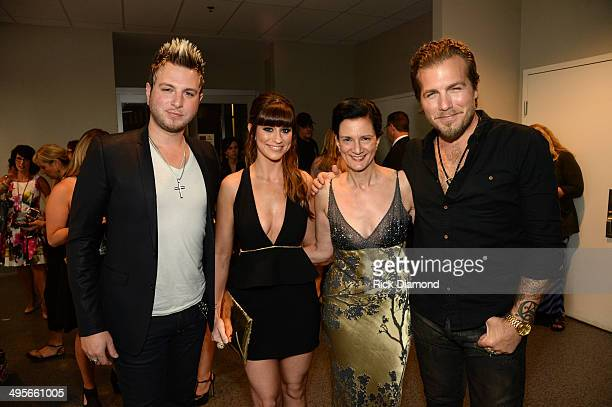 Senior Vice President of Music Strategy Leslie Fram poses with Mike Gossin Rachel Reinert and Tom Gossin of the band Gloriana backstage during the...