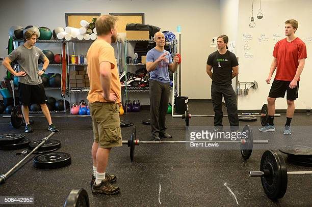 Senior Vice President of Oracle Data Cloud Eric Roza talks to employees before starting their session of crossfit in the gym at Oracle Data Cloud on...