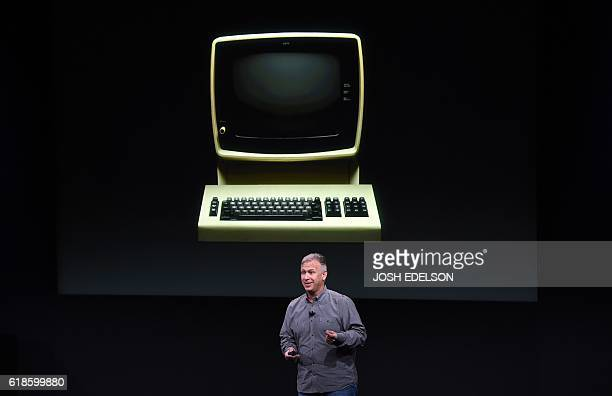 Senior Vice President of Worldwide Marketing Phil Schiller speaks in front of a projection of an old Apple computer during a product launch event at...