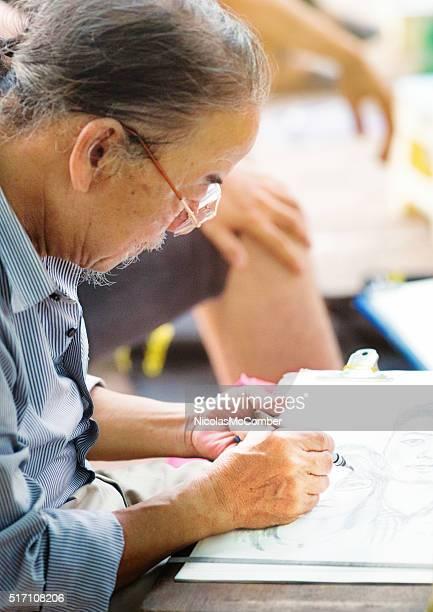 Senior Vietnamese sketch artist at work in Hanoi