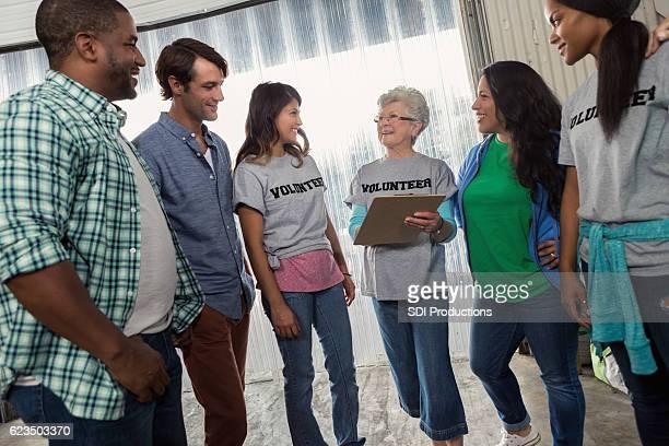 Senior volunteer coordinator gives assignments to volunteers