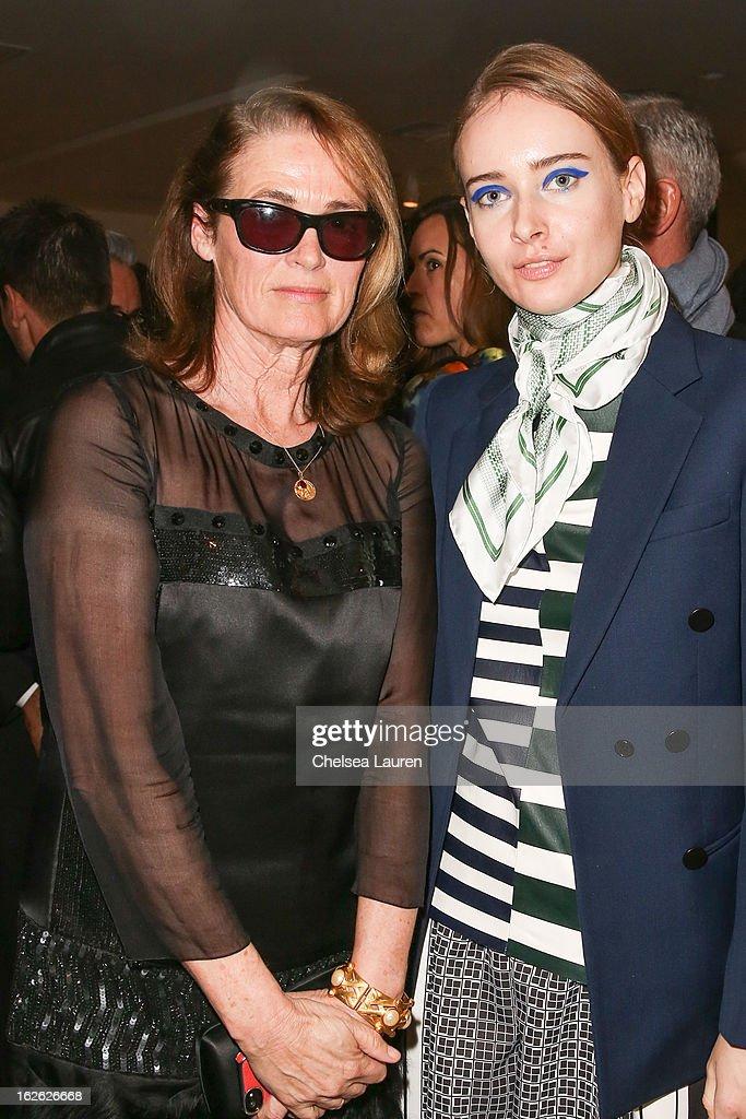 Senior West coast editor of Vogue Lisa Love (L) and Olga Sorokina visit the Mario Testino opening at PRISM during Academy Awards week on February 23, 2013 in Los Angeles, California.