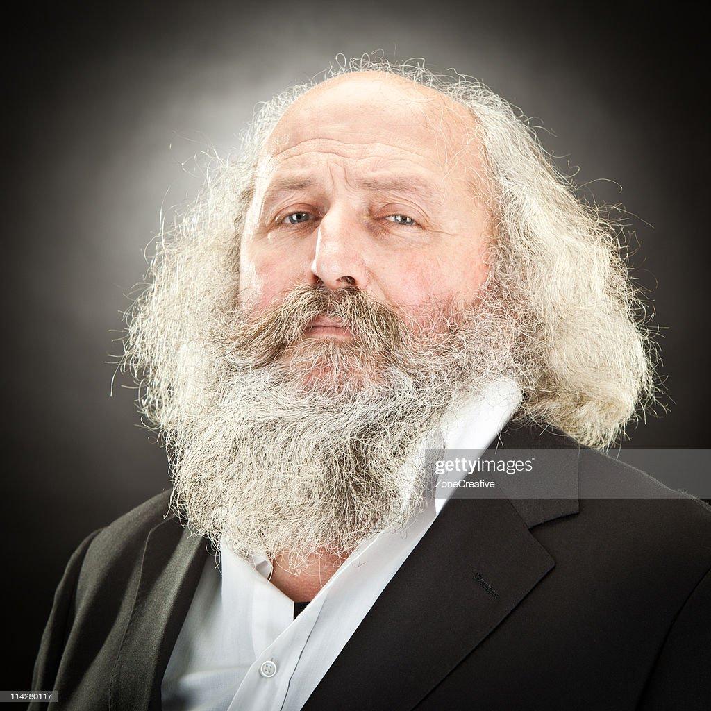 senior white bearded gentleman closeup on black : Stock Photo