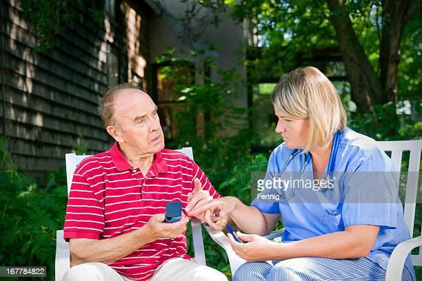 Senior with diabetes consulting a nurse or doctor