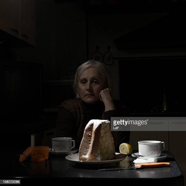 Senior woman alone in the kitchen