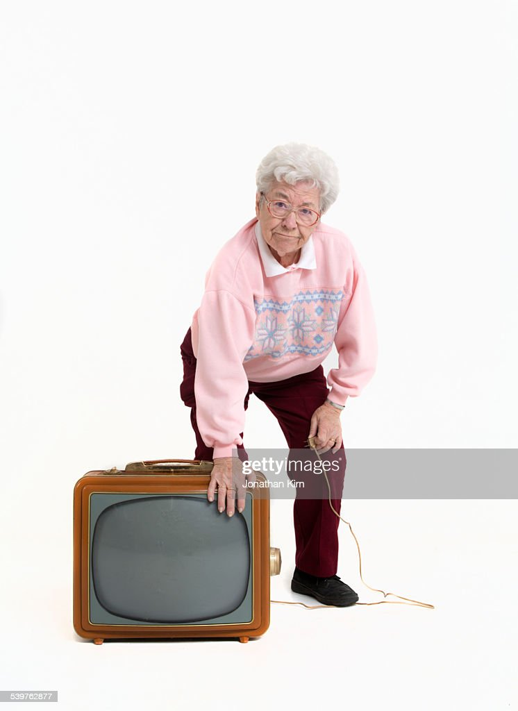 Senior woman and a 1950s style TV