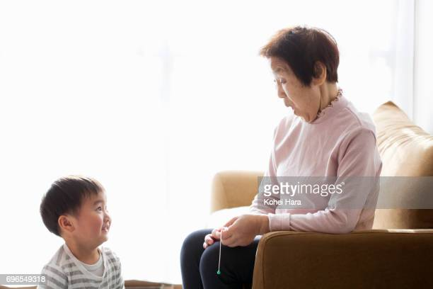 Senior woman and boy relaxed at home