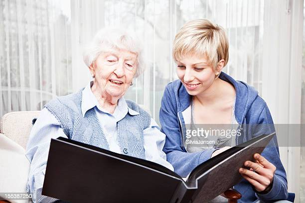 senior woman and caregiver sharing memories