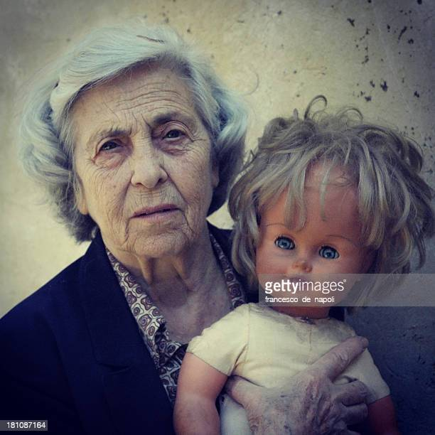 Senior woman and doll