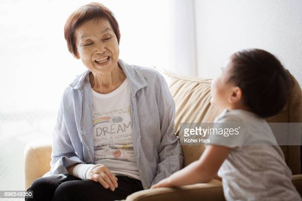 Senior woman and her grand son playing at home together