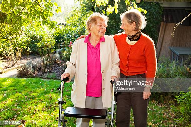 senior woman and mature daughter care