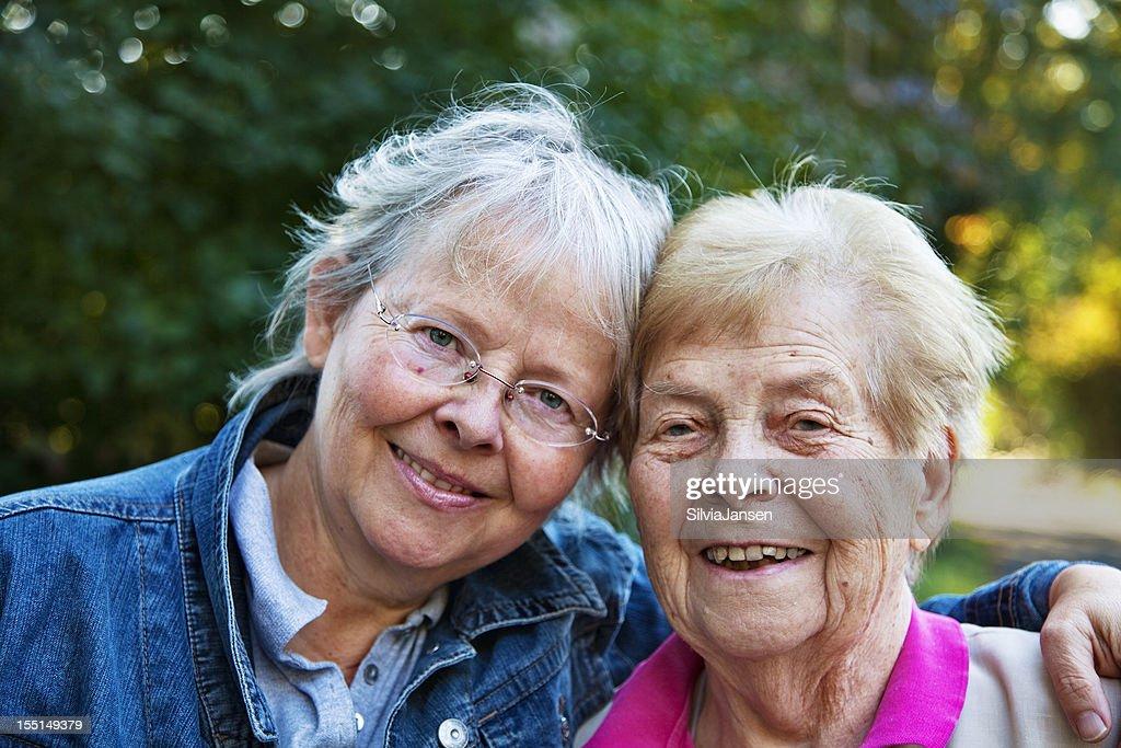 senior woman and mature daughter