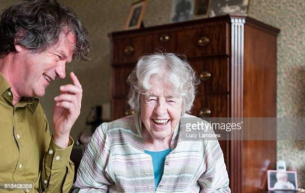 Senior woman and mature man laughing