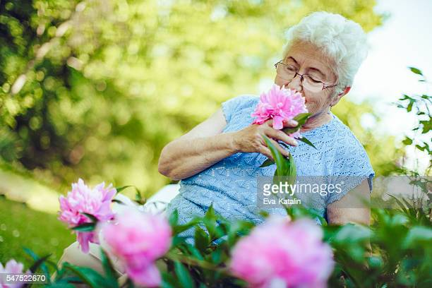 Senior woman and peony