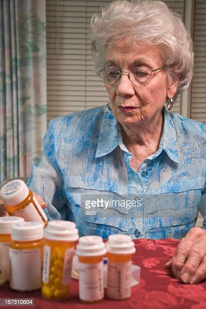 senior woman and prescription medication