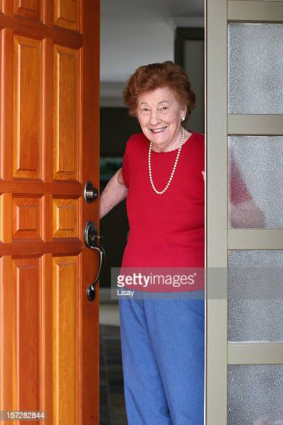 Senior Woman answering door
