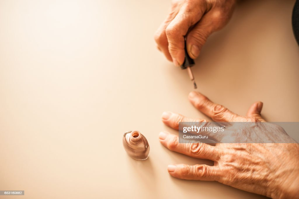 Senior Woman Applying Fingernails - Close Up Hands : ストックフォト