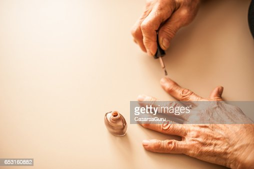 Senior Woman Applying Fingernails - Close Up Hands : Stock Photo