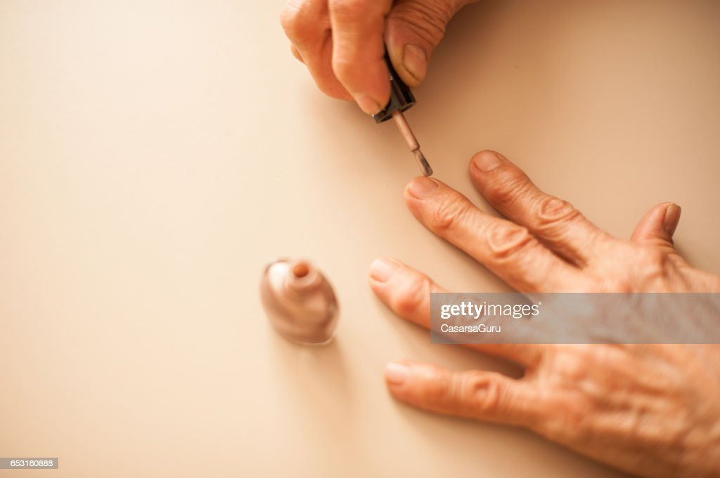 Senior Woman Applying Fingernails - Close Up Hands : Photo