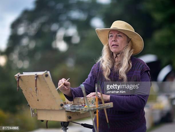Senior woman artist paints