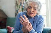 Senior Woman At Home Suffering With Arthritis