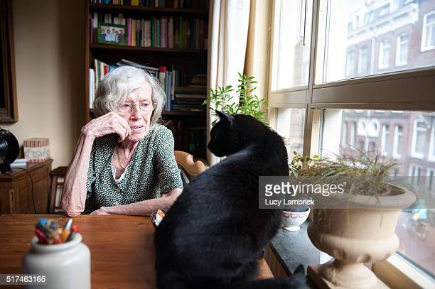 Senior woman at home with her cat