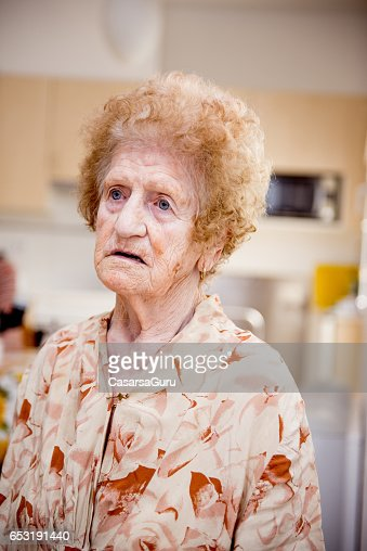 Senior Woman At The Nursing Home Sitting In The Dining Room : Photo