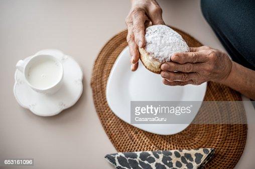 Senior Woman Break The Rules By Eating Donut : Stockfoto