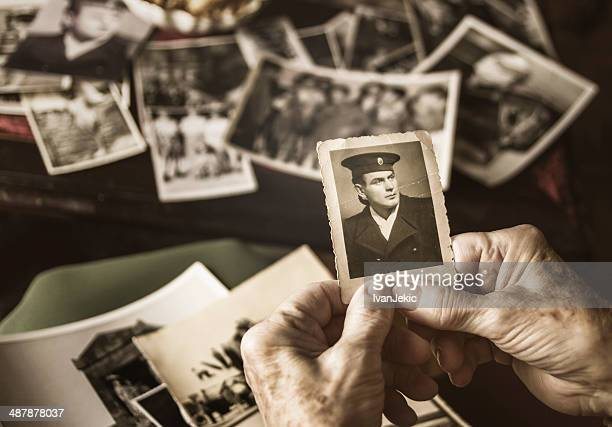 Senior woman browsing dear old photographs