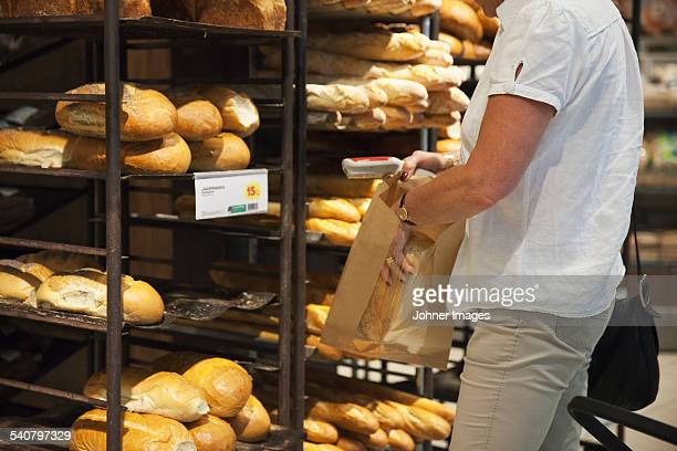 Senior woman buying bread