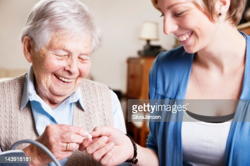 senior woman, caregiver and medicine : Stock Photo