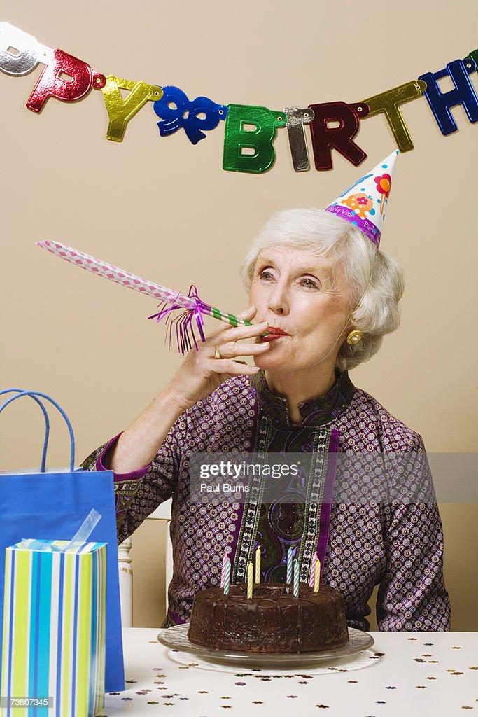 Senior woman celebrating birthday, indoors : Stock Photo
