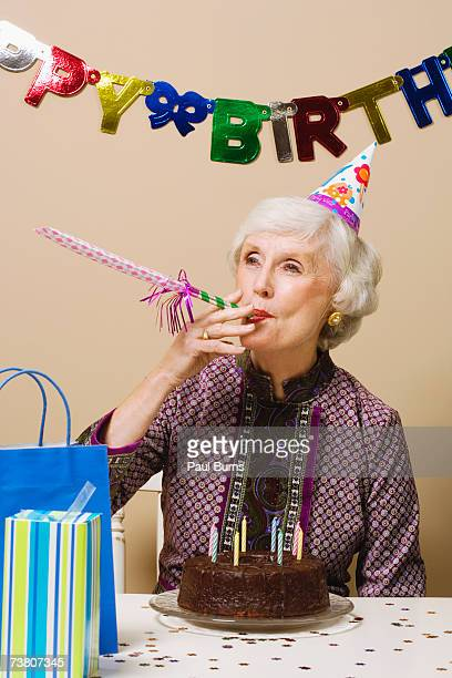 Senior woman celebrating birthday, indoors